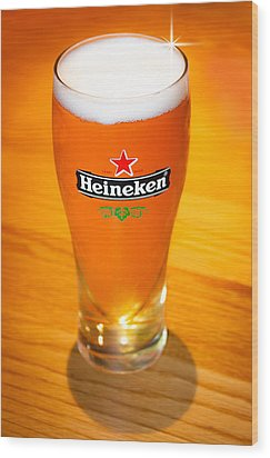 A Cold Refreshing Pint Of Heineken Lager Wood Print by Semmick Photo
