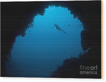 A Diver Explores A Cavern In Gorontalo Wood Print by Steve Jones