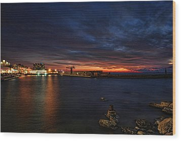 Wood Print featuring the photograph a flaming sunset at Tel Aviv port by Ron Shoshani