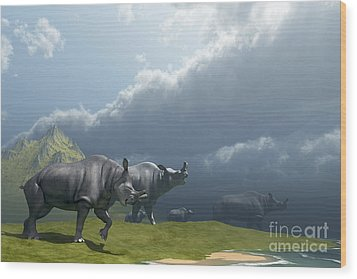 A Herd Of Brontotherium Dinosaurs Come Wood Print by Corey Ford