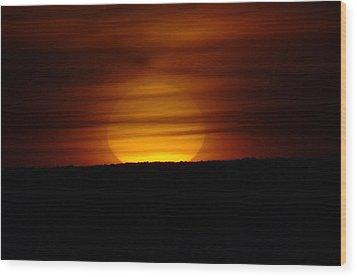 A Misted Sunset Wood Print by Jeff Swan