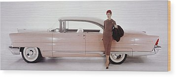 A Model Posing In Front Of A Vintage Car Wood Print by Karen Radkai