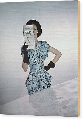 A Model Wearing A Floral Blue Dress Wood Print by Constantin Joffe