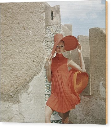 A Model Wearing A Orange Dress Wood Print by Henry Clarke