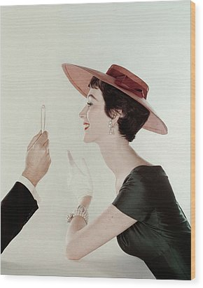 A Model Wearing A Sun Hat And Dress Wood Print by John Rawlings