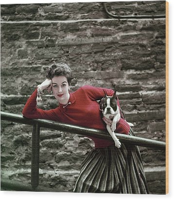 A Model With A Dog Leaning On A Railing Wood Print by Richard Rutledge