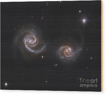 A Pair Of Interacting Spiral Galaxies Wood Print by Roberto Colombari