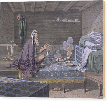 A Persian Doing His Morning Prayers Wood Print by E. Karnejeff