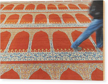 A Person Walking Over The Colourful Wood Print by Keith Levit