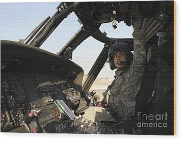 A Uh-60 Black Hawk Helicopter Wood Print by Stocktrek Images