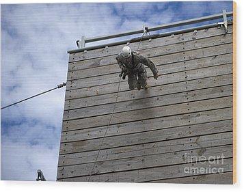 A U.s. Soldier Runs Down A 40-foot Wood Print by Stocktrek Images