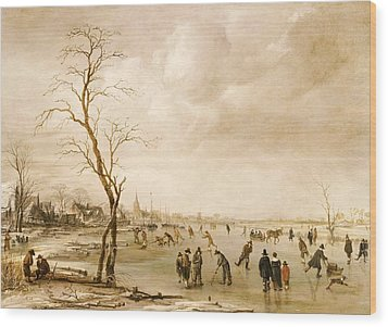 A Winter Landscape With Townsfolk Skating And Playing Kolf On A Frozen River Wood Print by Aert van der Neer