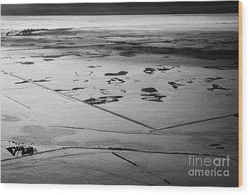 aerial view of snow covered prairies and remote isolated farmland in Saskatchewan Canada Wood Print by Joe Fox
