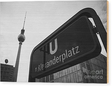Alexanderplatz U-bahn Station Entrance Sign And Tv Tower Berliner Fernsehturm Berlin Germany Wood Print by Joe Fox