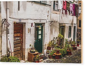 Alfama Houses Wood Print by Paul Donohoe
