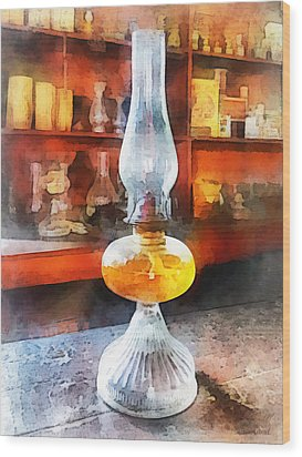 Americana - Hurricane Lamp In General Store Wood Print by Susan Savad