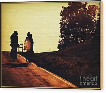 Amish Family Cycles Into Sunset Wood Print by Beth Ferris Sale