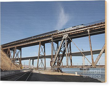 Amtrak Train Riding Atop The Benicia-martinez Train Bridge In California - 5d18775 Wood Print by Wingsdomain Art and Photography