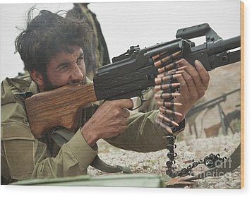 An Afghan Local Police Officer Fires Wood Print by Stocktrek Images