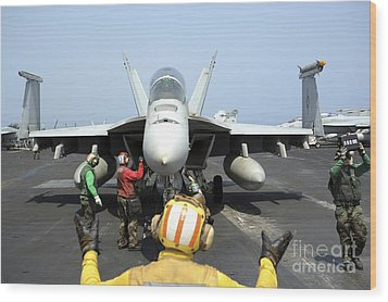 An Aircraft Director Signals Wood Print by Stocktrek Images