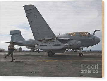 An Ea-6b Prowler Prepares To Launch Wood Print by Stocktrek Images
