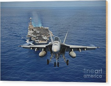 Wood Print featuring the photograph An Fa-18 Hornet Demonstrates Air Power. by Paul Fearn