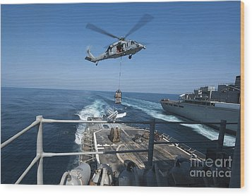 An Mh-60s Sea Hawk Brings Pallets Wood Print by Stocktrek Images
