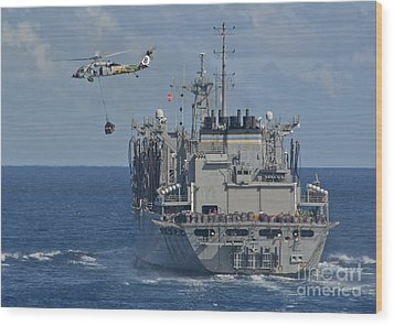 An Mh-60s Sea Hawk Conducts A Vertical Wood Print by Stocktrek Images
