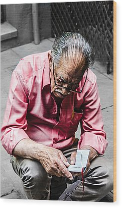 An Old Man Reading His Book Wood Print by Sotiris Filippou