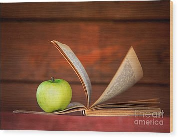 Apple And Book Wood Print by Michal Bednarek