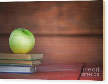 Apple On Pile Of Books Wood Print by Michal Bednarek