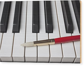 Artist Brush On Piano Keys Wood Print by Garry Gay