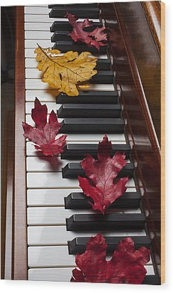 Autumn Leaves On Piano Wood Print by Garry Gay