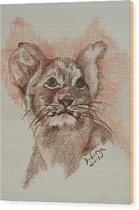 Baby Lion Wood Print by Deborah Gorga