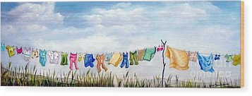 Baby's Clothesline Wood Print by Anna-maria Dickinson