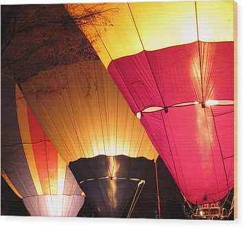 Balloons At Night Wood Print by Laurel Powell