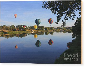 Balloons Heading East Wood Print by Carol Groenen