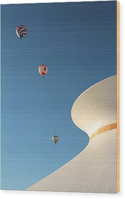 Balloons Race Over The Planetarium Wood Print by Scott Rackers