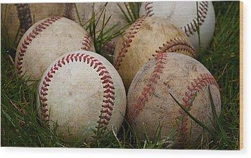 Baseballs On The Grass Wood Print by David Patterson