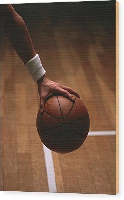 Basketball Ball In Male Hands Wood Print by Lanjee Chee