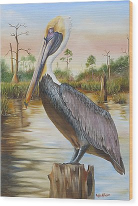 Bayou Coco Point Pelican Wood Print by Phyllis Beiser