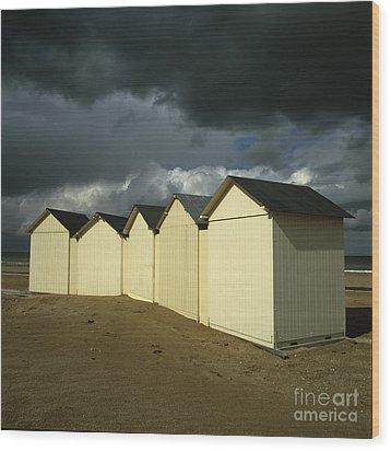 Beach Huts Under A Stormy Sky In Normandy. France. Europe Wood Print by Bernard Jaubert
