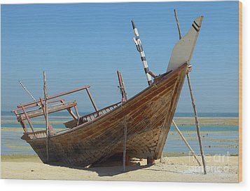 Beached Dhow At Wakrah Wood Print by Paul Cowan