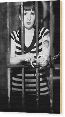 Wood Print featuring the photograph Behind Bars by Jim Poulos