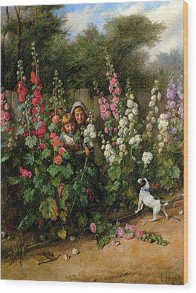Behind The Hollyhocks Wood Print by Charles Hunt