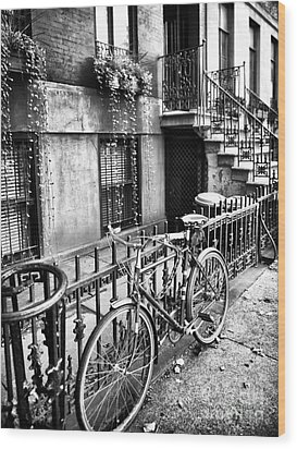Bicycle In The Village Wood Print by John Rizzuto