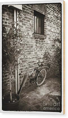 Bike In Pirates Alley Wood Print by John Rizzuto