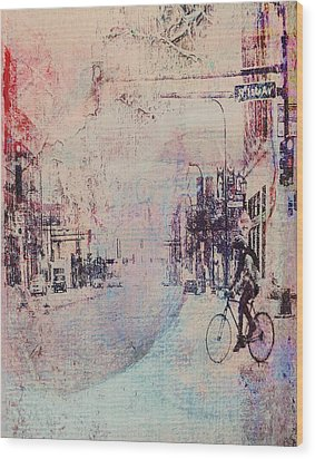 Biking In The City Wood Print by Susan Stone