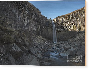 Wood Print featuring the photograph Black Waterfall by Gunnar Orn Arnason
