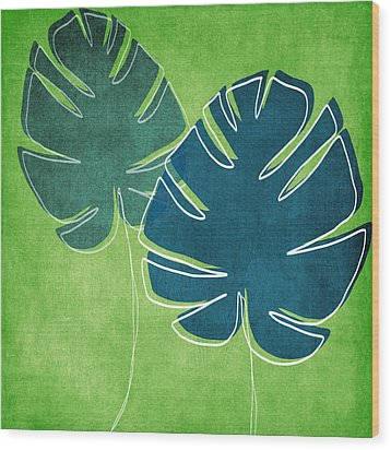 Blue And Green Palm Leaves Wood Print by Linda Woods